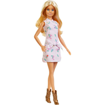 Barbie doll is the original body shape and wears a pink and white striped shirt dress with floral print​.