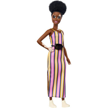 Barbie doll has a more petite body than the original and has vitiligo areas on her face, neck and hands.​