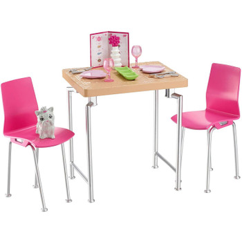 "The"" wooden"" table and two pink chairs have silvery legs for a modern touch."