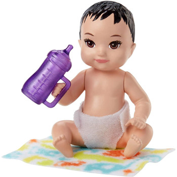 The baby doll has movable arm and leg joints so that it can be put to sleep and sits on its blanket.