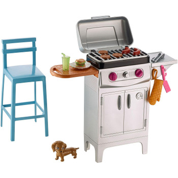 Summery themes set the scene for a perfect day outside — like this silvery grill and tall blue stool.