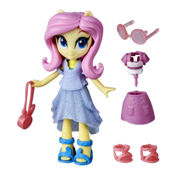 This Fluttershy mini doll comes with 7 character-inspired outfit pieces and accessories, 4 of which are hidden for a fashion surprise!