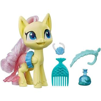 PLAY DRESS UP WITH FLUTTERSHY: Imagine Fluttershy is dressing up in a mermaid costume with her fun fashion accessories, including a mermaid tail skirt!