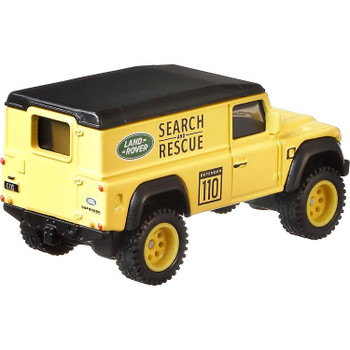 Approximately 1:64 scale, this Land Rover Defender model measures around 7 cm (2.75 inches) long.