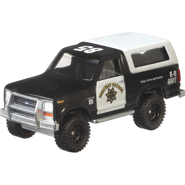 The '85 Ford Bronco features a black & white Highway Patrol livery.