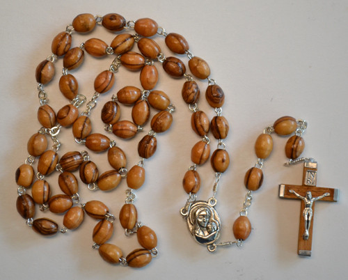 Olivewood rosary with soil and water in the centerpiece