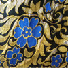 M02 black background with gold leaves and blue flowers in an asymmetrical pattern