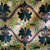 M01 gold metallic background with black and lime green flowers and Red ribbons in symmetrical pattern