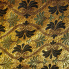 M03 gold metallic background with black and lime green flowers and brown ribbons in symmetrical pattern