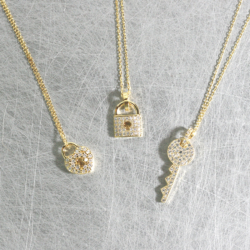 CZ Gold Key Charm Necklace Sterling Silver from kellinsilver.com