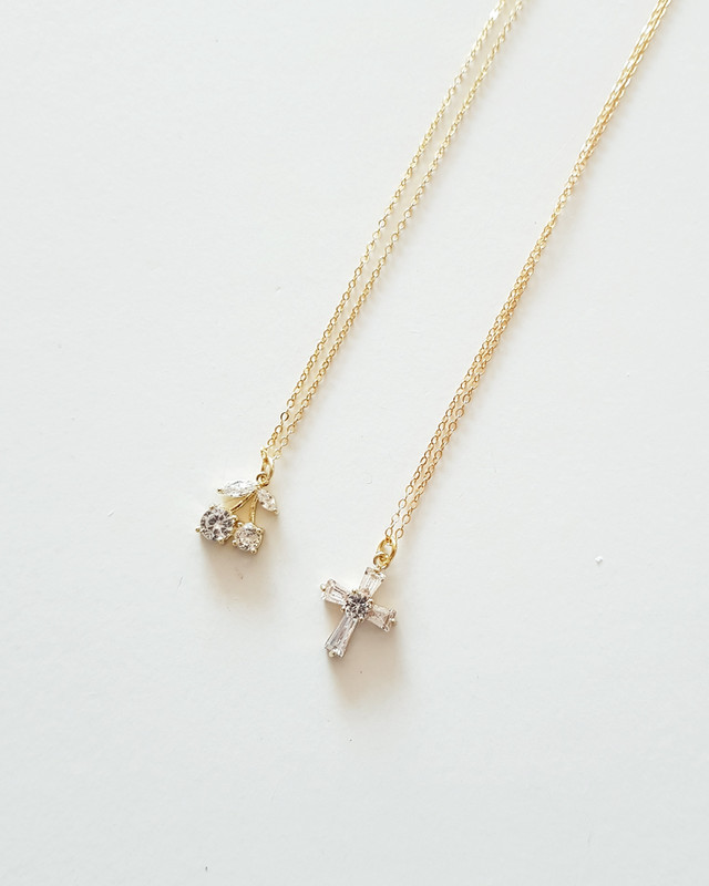 Gold Tiny CZ Cross Necklace in Sterling Silver on kellinsilver.com