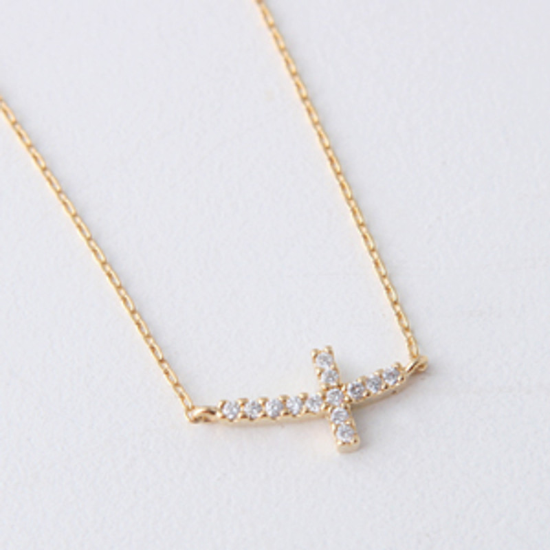 Yellow Gold Swarovski Curved Sideways Cross Necklace Sterling Silver from kellinsilver.com