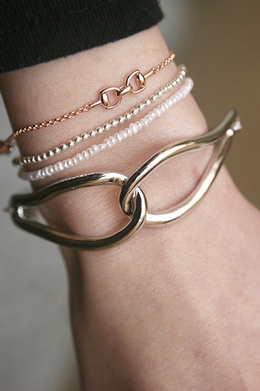 Sterling Silver Infinity Knot Bracelet White Gold from kellinsilver.com
