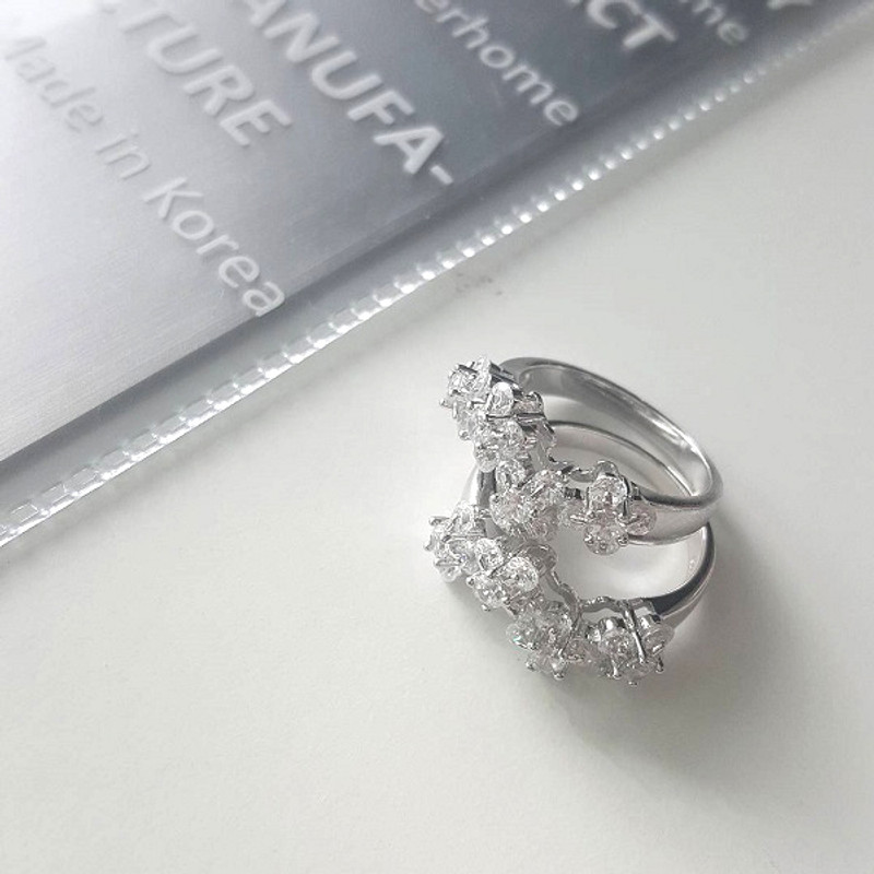 White Gold Blossom Wedding Ring Sterling Silver from kellinsilver.com