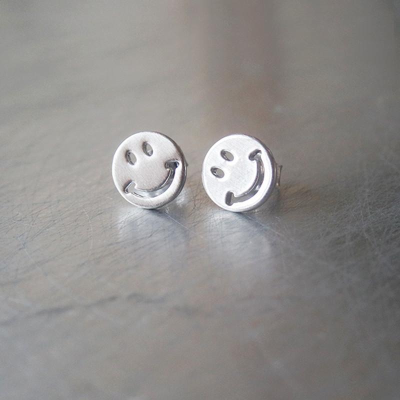 White Gold Smile Stud Earrings from kellinsilver.com
