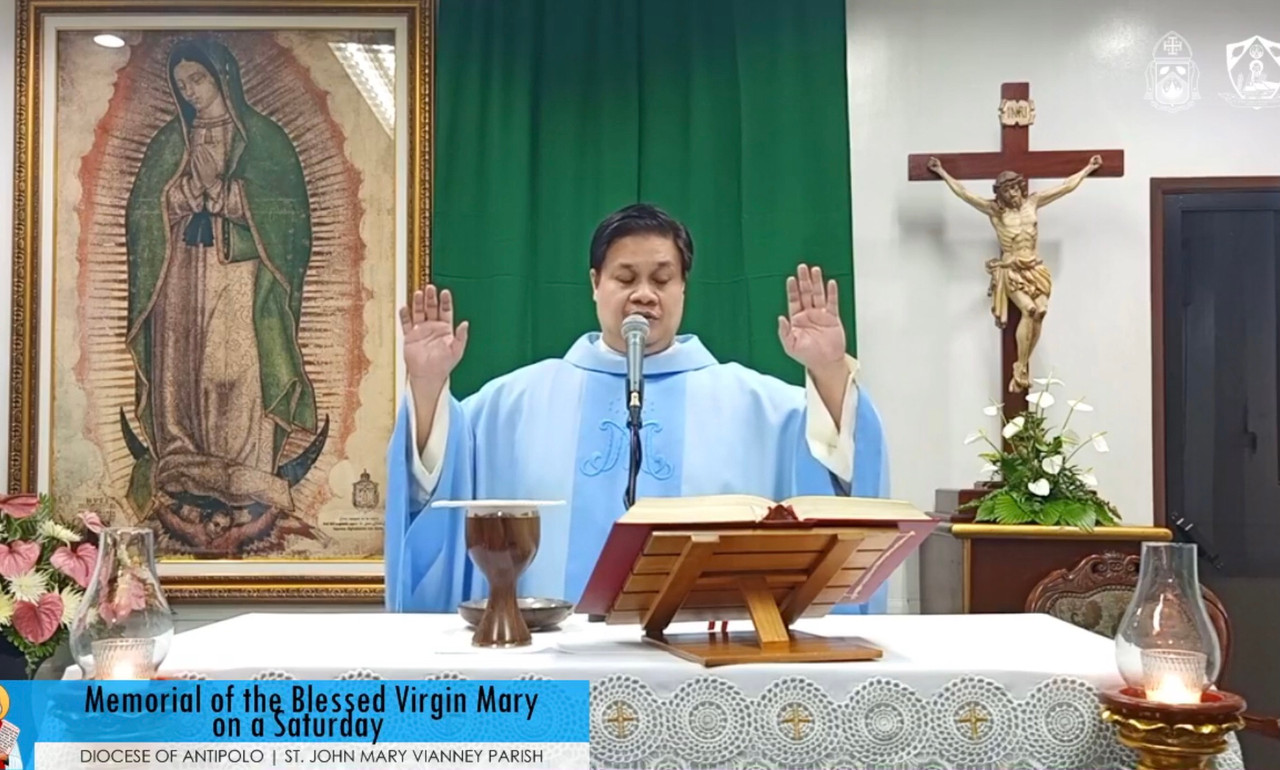 In the Philippines, Father Jeffrey Quintela celebrates Mass before a framed image of Our Lady of Guadalupe life sized tilma.