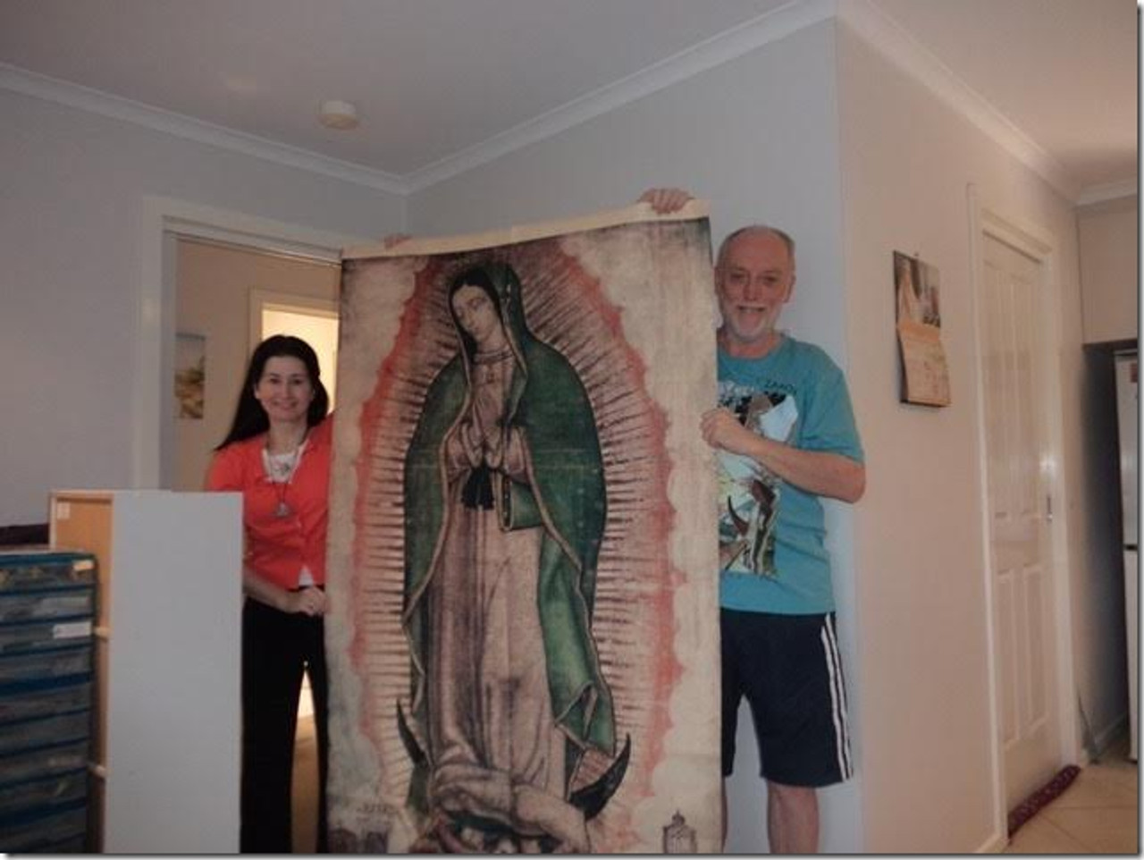 Irene and Mario M display tilma of Our Lady of Guadalupe