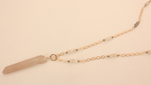 RACA's collections are inspired by elements in nature. Handmade, this lariat necklace is adorned with faceted sunstones and pyrites wrapped with silver plated gold. The centerpiece is a lithium quartz point from Brazil. Wear yours with everything from dresses to T-shirts. Finished with a matte gold lobster clasp.