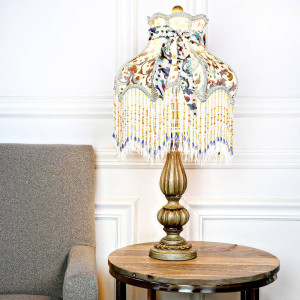 Victorian Floral Lamp with light on in room setting