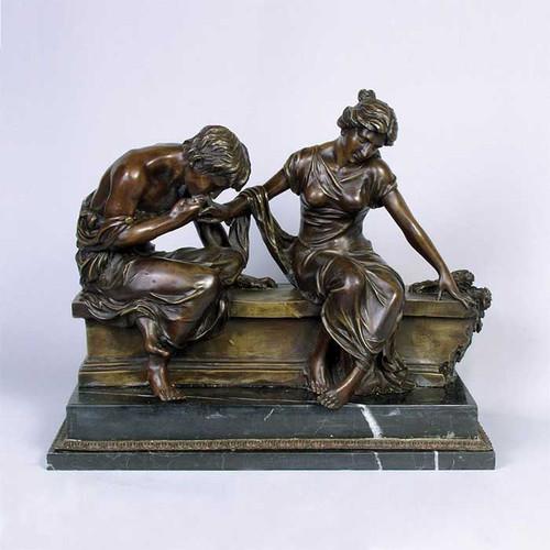 Bronze Couple On Wall