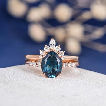 7*9mm Oval Cut London Blue Topaz Unique Engagement Ring Set