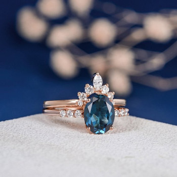 7*9mm Oval Cut London Blue Topaz Unique Engagement Ring Set