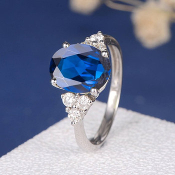 8*10mm Oval Lab Sapphire Unique Cluster Diamond Engagement Ring