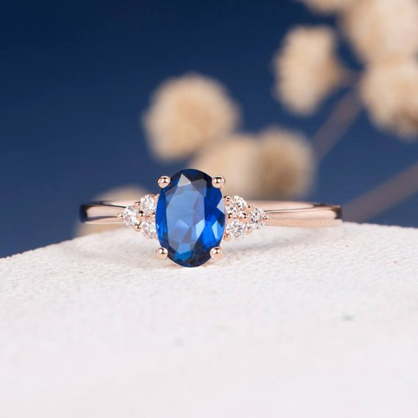 5*7mm Oval Lab Sapphire Diamond Cluster Engagement Ring