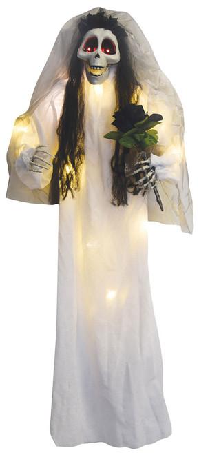 Mariee illuminee avec un bouquet