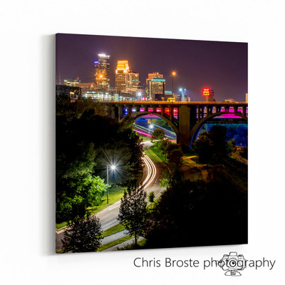 Side view of an art piece on the wall showing Minneapolis skyline over the Mississippi River and West River Road