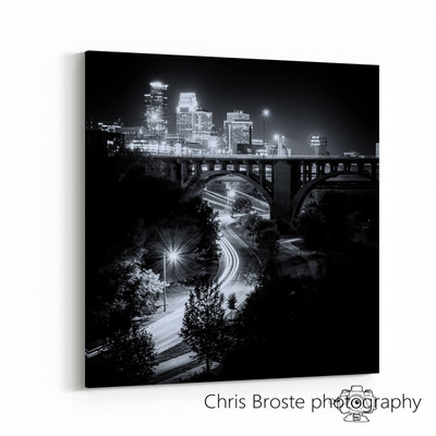 Side view of a gallery canvas wrap on wall showing a black and white Minneapolis skyline.