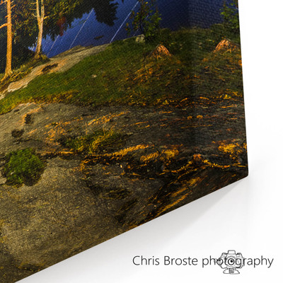 Corner view of a canvas wrap showing star trails in the night sky above the Boundary Waters