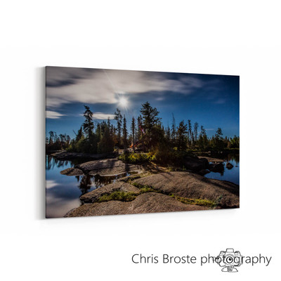 Side view of wall art showing a camp in the Boundary Waters under a full moon.