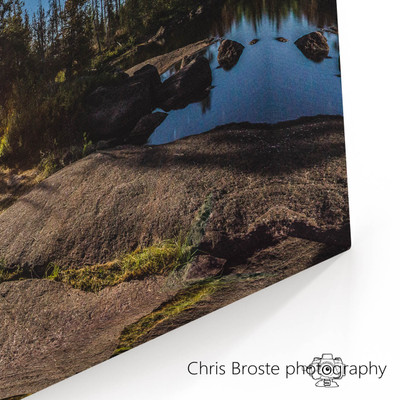 Corner view of wall art showing a camp in the Boundary Waters under a full moon.