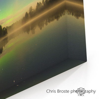 Corner view of a canvas wrap showing the northern lights in the Boundary Waters.