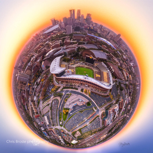 TCF Bank Stadium and Minneapolis seen from above in a 360 degree planet panorama photograph.