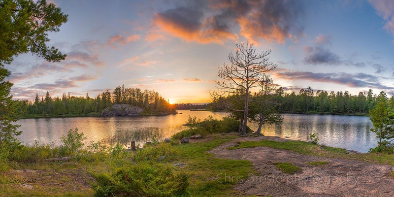 Panoramic view from a Boundary Waters lakeside campsite during sunset.
