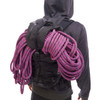 Man wearing Ultimate Direction SCRAM pack, rear view, carrying climbing rope  on pack
