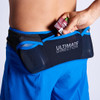 Man removing snacks from pocket of Ultimate Direction Men's Hydro Short