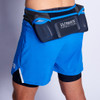 Man wearing Ultimate Direction Men's Hydro Short, rear view, with water bottles