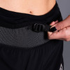 Close up of Woman wearing Ultimate Direction Women's Hydro Short, showing adjustable nylon waist belt