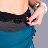 Close up of Woman wearing Ultimate Direction Women's Hydro Skirt, showing adjustable nylon waist belt