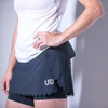 Woman wearing Ultimate Direction Women's Hydro Skirt, side view, with hand on hip