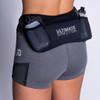 Woman wearing Ultimate Direction Women's Hydro Skin Short, rear view