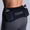 Woman wearing Ultimate Direction Women's Hydro 3/4 Tight, rear view, with water bottles