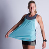 Woman wearing Ultimate Direction Women's Hydro Tank, very happy with how stretchy the fabric is!