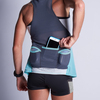 Woman wearing Ultimate Direction Women's Hydro Tank, putting phone into center pocket