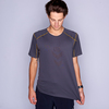 Man wearing Ultimate Direction Men's Ultralight Tee, stretching shirt to demonstrate the elasticity of the fabric