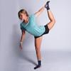 Woman wearing Ultimate Direction Women's Ultralight Tee, in yoga pose