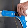 Man inserting key into waist belt pocket of Ultimate Direction Ultra Belt 5.0